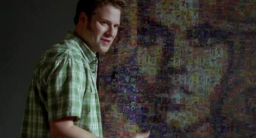 Seth Rogen in front of Barbarella mosaic poster. Still frame from &lquot;Funny People&rquot; movie.